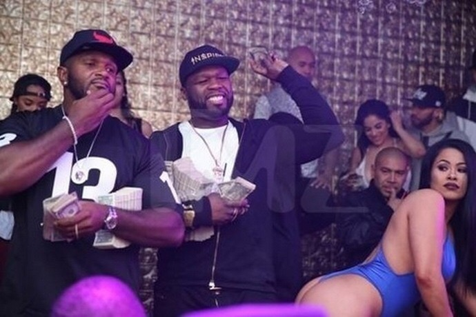 50 Cent Pictured Holding Stacks of Money at Strip Club Despite Bankruptcy Filing